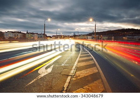 Traffic at the sunset, Prague - blurred motion - stock photo