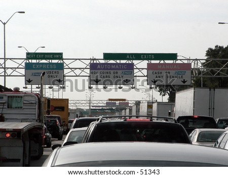traffic at the toll booth - stock photo