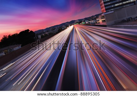 Traffic at twilight on 405 freeway in Los Angeles, California. Blurred Motion. - stock photo