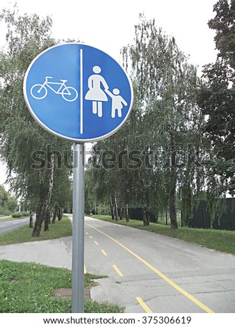 Traffic bicycle road sign with pedestrian crossing sign