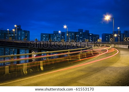 traffic bridge at night in hong kong. - stock photo