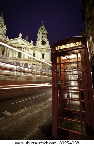 Traffic by St Paul's Cathedral at dusk, London. Blurred motion trail of bus passing by. - stock photo