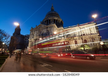 Traffic by St Paul's Cathedral at night, London. Blurred motion of passers-by and traffic - stock photo