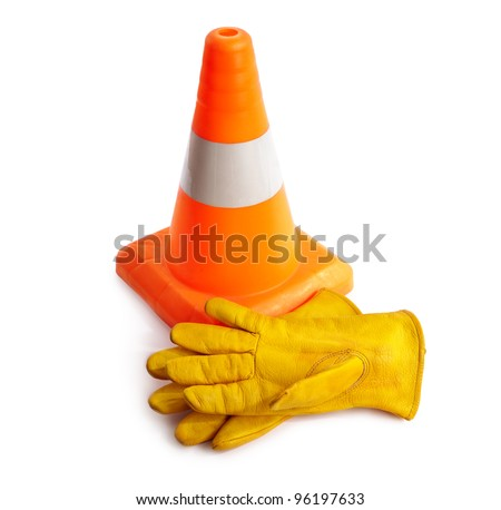 Traffic cone and working gloves isolated on white background - stock photo
