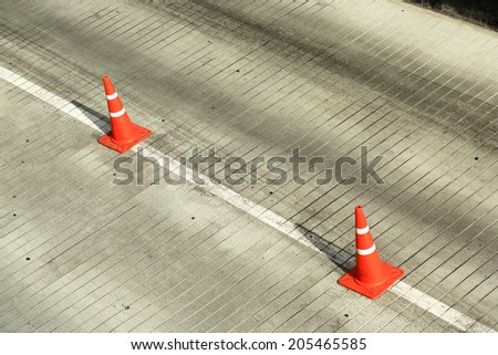 traffic cone on the road - stock photo