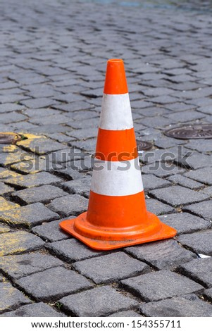 traffic cone on the sett  - stock photo