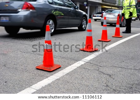 Traffic cones and aide - stock photo