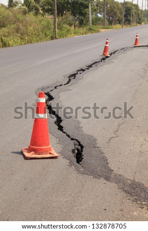 Traffic cones on the cracked asphalt road