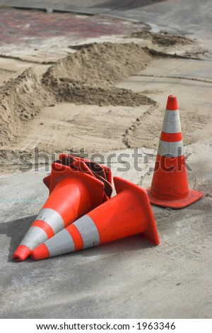 traffic cones, scatered on a road work site - stock photo