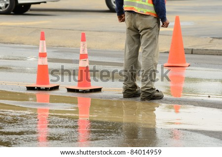 Traffic control at an effort to repair a 12 inch water main failure on Harvard Ave in Roseburg OR - stock photo