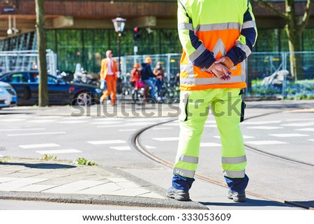 Traffic control manager watching order on the urban road - stock photo