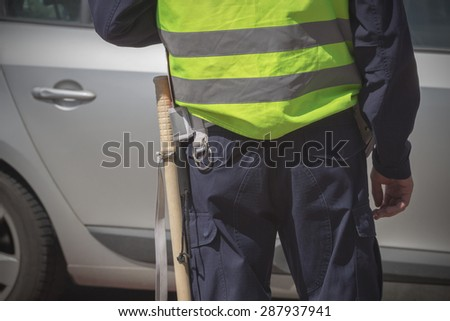 Traffic cop checking the traffic. - stock photo