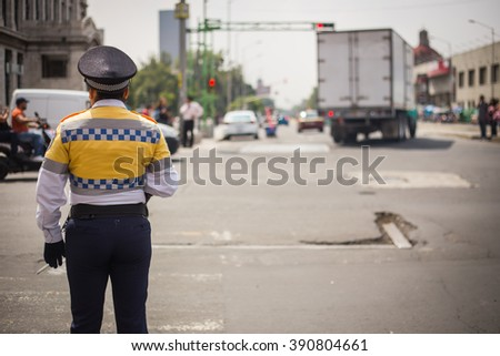 Traffic cop checking the traffic in mexico city. - stock photo