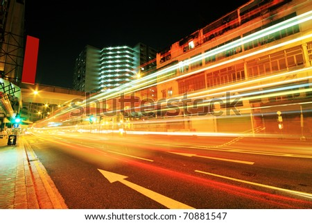 traffic downtown at night, hongkong - stock photo