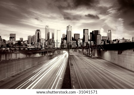 Traffic escaping a post apocalyptic city - stock photo