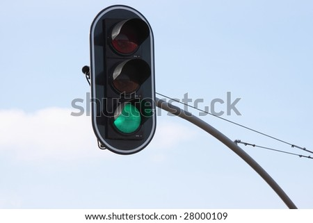 Traffic green light over blue sky background - stock photo