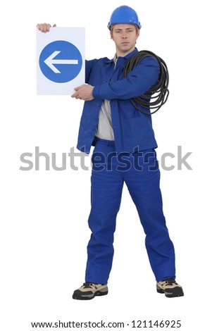 Traffic guard directing traffic - stock photo