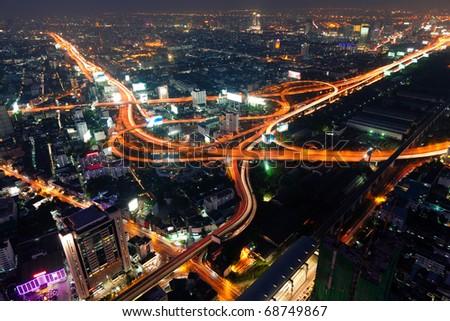 Traffic in Bangkok by night - stock photo