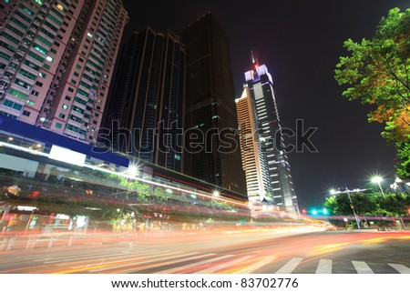 traffic in downtown of guangzhou at dusk - stock photo
