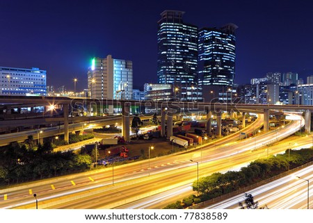 traffic in modern city at night - stock photo