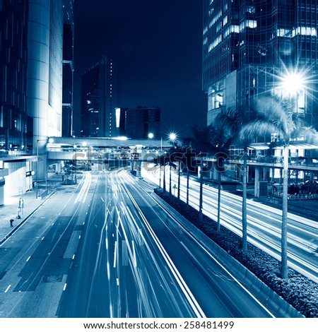 traffic in modern city at night, Hong Kong. - stock photo