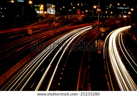 traffic in motion at night. - stock photo