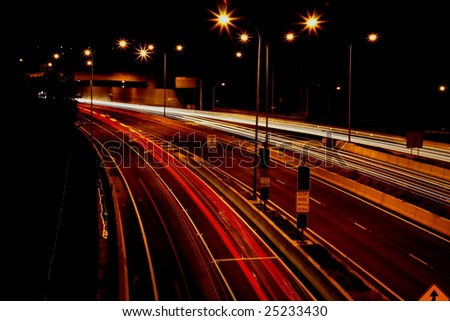 traffic in motion at night - stock photo