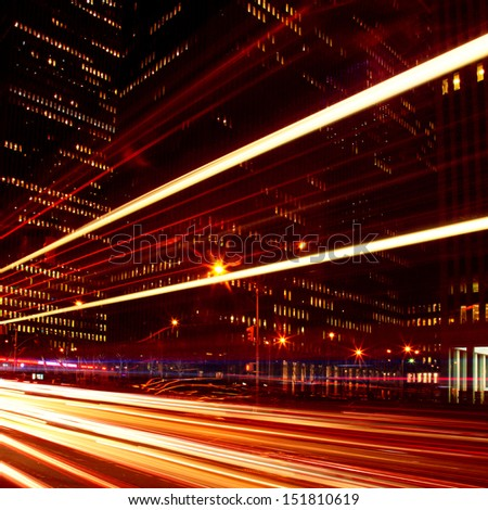 Traffic in the city at twilight. - stock photo