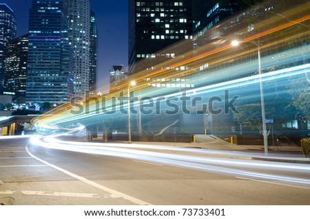 Traffic in the city seen as trails of light - stock photo