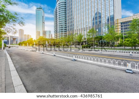 traffic in the downtown district,tianjin china. - stock photo