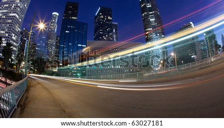 Traffic into the city of Los Angeles with traffic seen as trails of light - stock photo