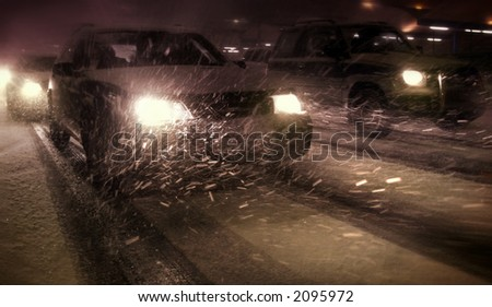 traffic jam and a snow storm - stock photo