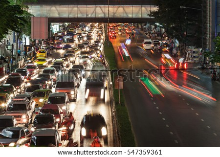 Traffic jam at the night street in megalopolis