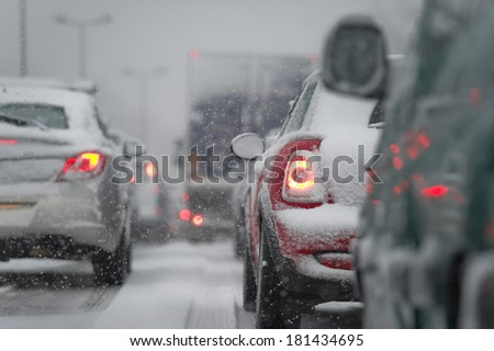 Traffic jam caused by heavy snowfall - stock photo