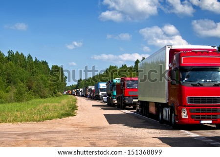 Traffic jam congestion. Trucks in a row.  - stock photo
