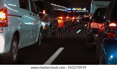 traffic jam in an urban tunnel. Lot of cars in a row - stock photo