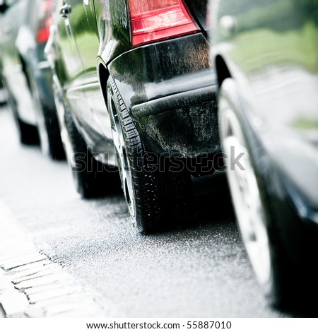 Traffic jam in flooded highway cause rain - stock photo