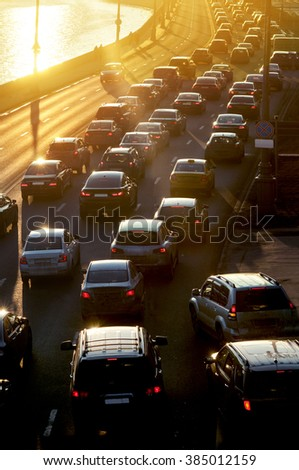 Traffic Jam in sunset beams - stock photo