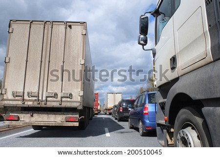 traffic jam on a  highway - stock photo