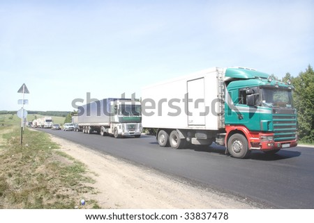 traffic jam on the country road - stock photo