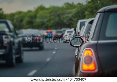 traffic jam with row of cars on express way during rush hour,  before night, selective focus as rear window - stock photo