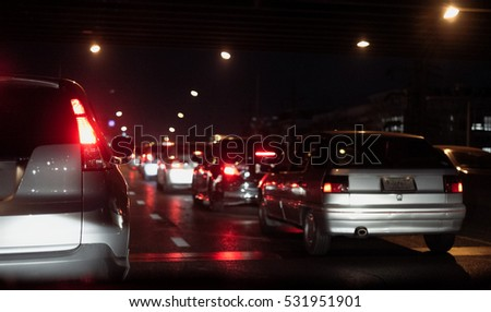 Traffic jams in the city with row of cars on the road at night. (with selective focus)