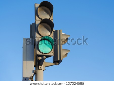 Traffic light against the blue sky with burning green signal - stock photo