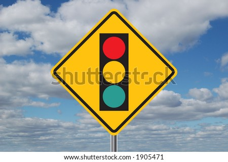Traffic light ahead sign with clouds in the background - stock photo