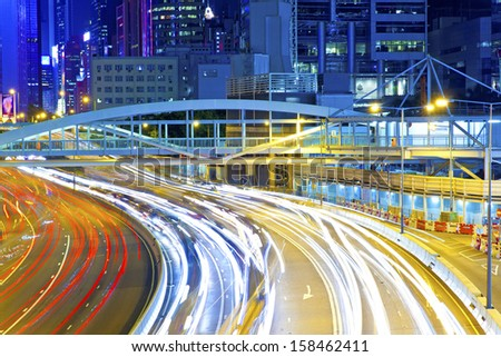 Traffic light curving lines on road during rush hour - stock photo