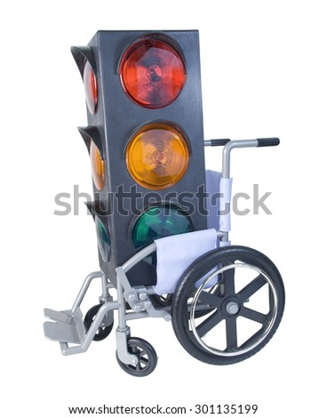 Traffic light in a Wheelchair used for assistance in personal transportation - path included - stock photo