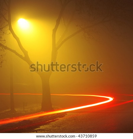 Traffic light in motion blur - stock photo