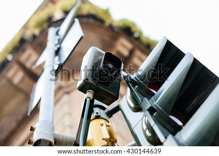 Traffic light in old city - stock photo