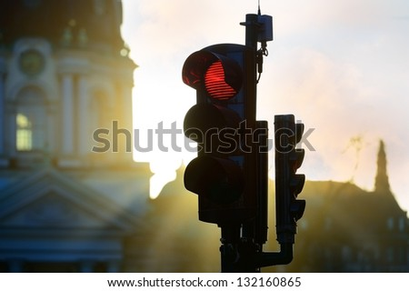 Traffic light in sunset - stock photo