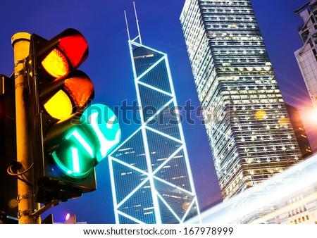 Traffic light in the modern city at night, hong kong. - stock photo